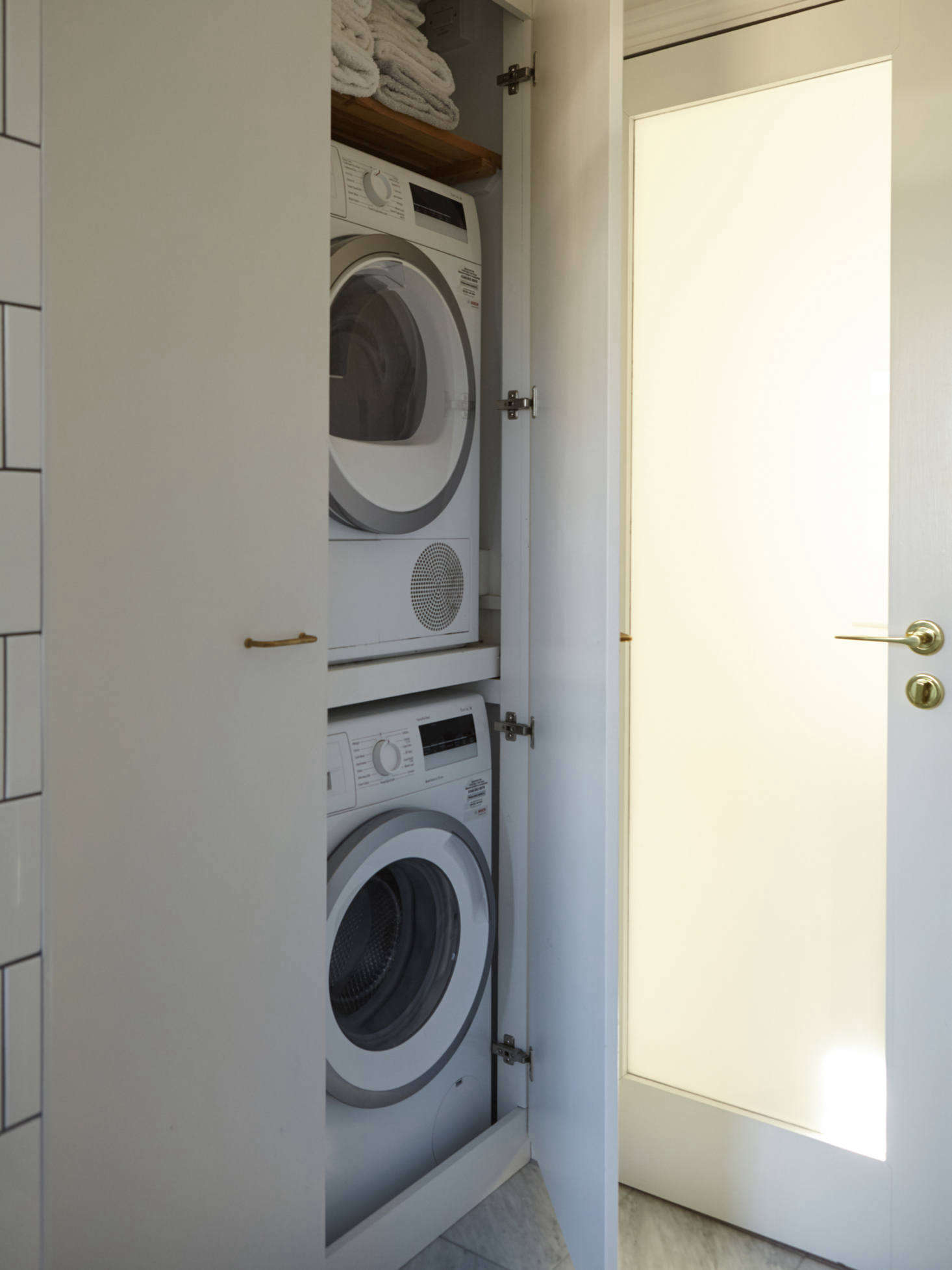 Compact London living means integrating the washer/dryer into the bath as well.Photograph by Richard Round-Turner fromA Star Is Born: A Rehabbed London Maisonette from a Newly Minted Designer, High/Low Secrets Included.