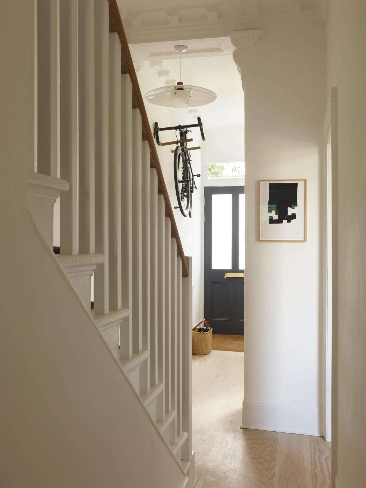 The entryway, with a glass hanging light (&#8
