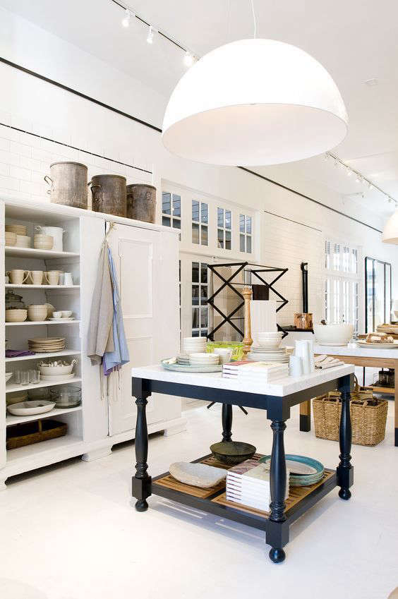 At San Francisco kitchen store March, a36-inch custom hand-built fiberglass and resinDome Light Fixture, available by special order from March, illuminates the working kitchen area.