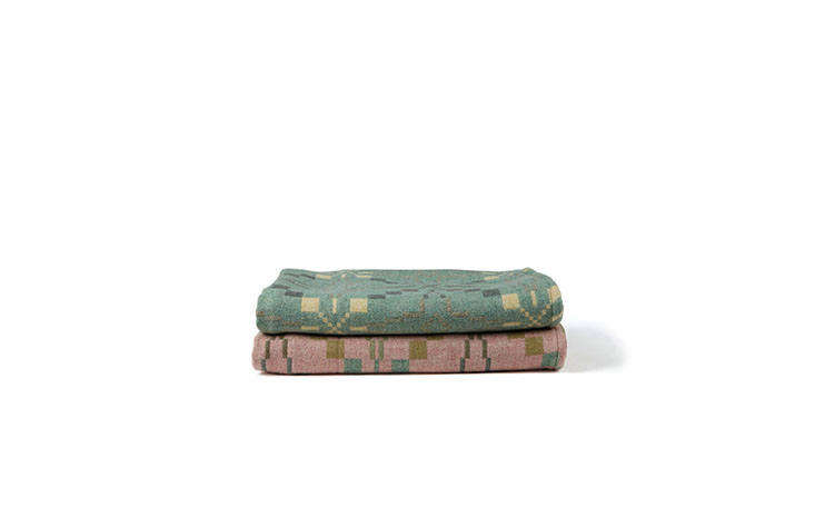 The Vintage Star Throw in Mint (on the top) andBlossom(on the bottom) are reproductions of a 50s design, both available from Another Country for £9. (The pink version is also available from Rowen & Wren for £0 and from Cb