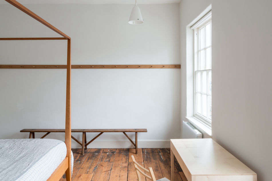 A peg rail, a Remodelista storage favorite, bisects one wall of the bedroom. (See Object Lessons: The Shaker Peg Rail (Plus Five to Buy).