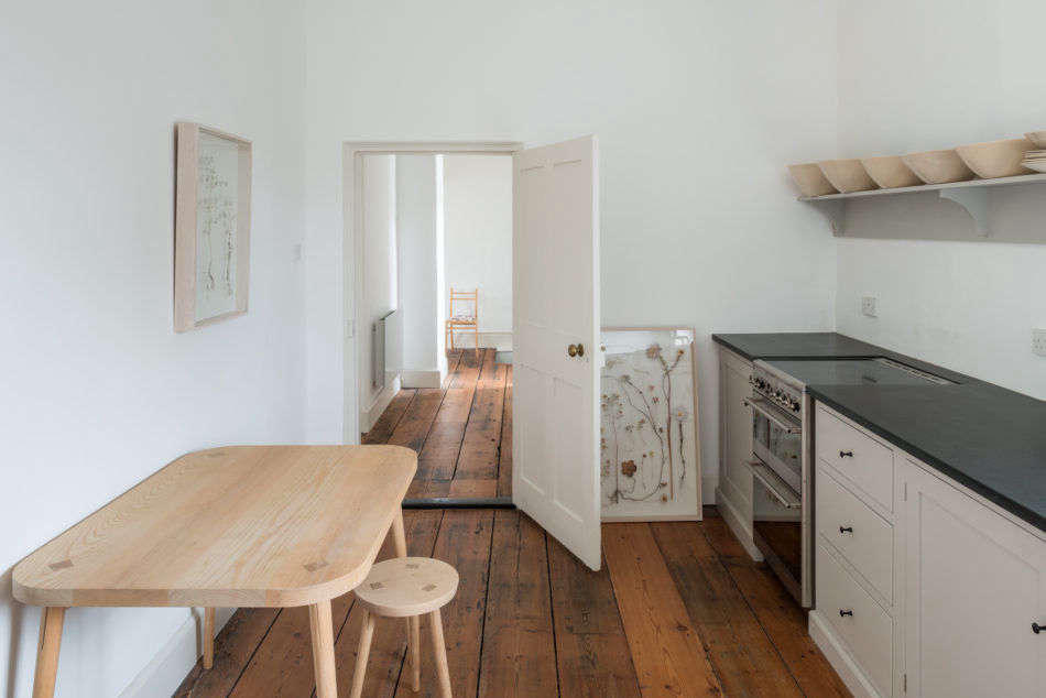 A wood table and stool by carpenter Karin Ekwall anchors the kitchen.
