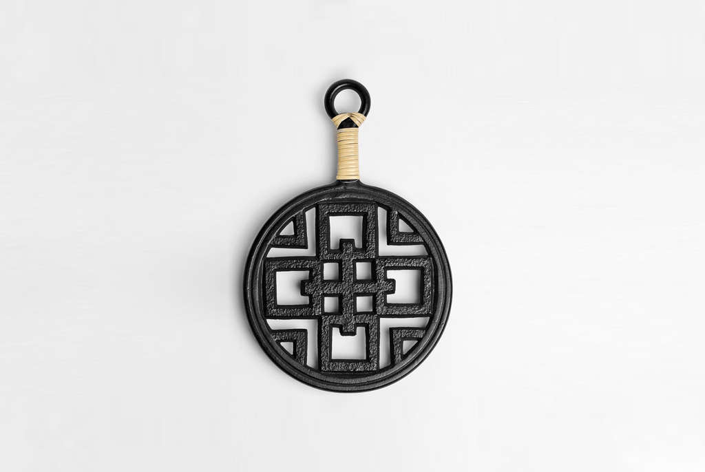 Made in Japan by the lateironware craftsman Rikuchou Ogasawara, the Iron Trivet With Handle is