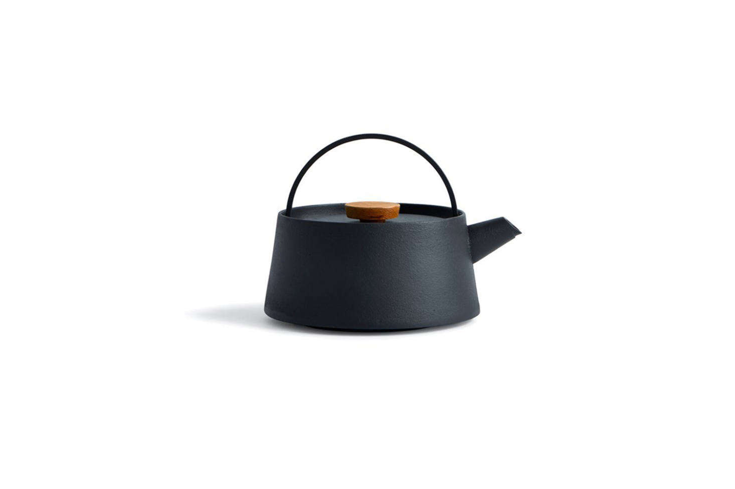 The swinging handle of the Tetu Cast Iron Kettle by Koizumi Studio can be folded down, making it easy to remove the lid; $550 at Nalata Nalata.