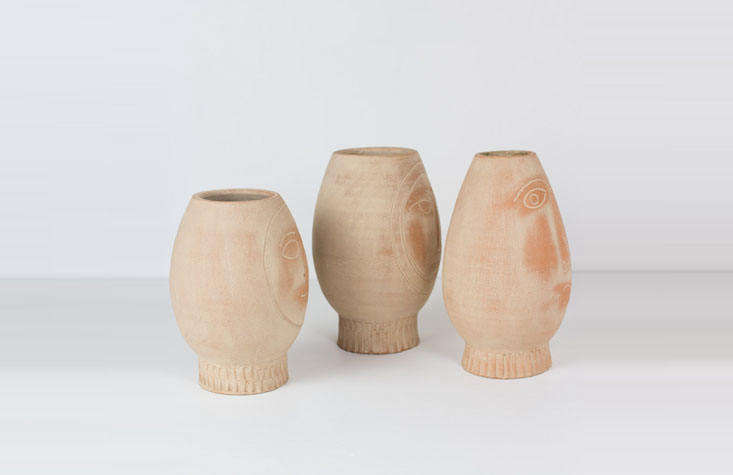 The pots, sleuthed; a set of three Clay Face Pots are $90 from At West End.