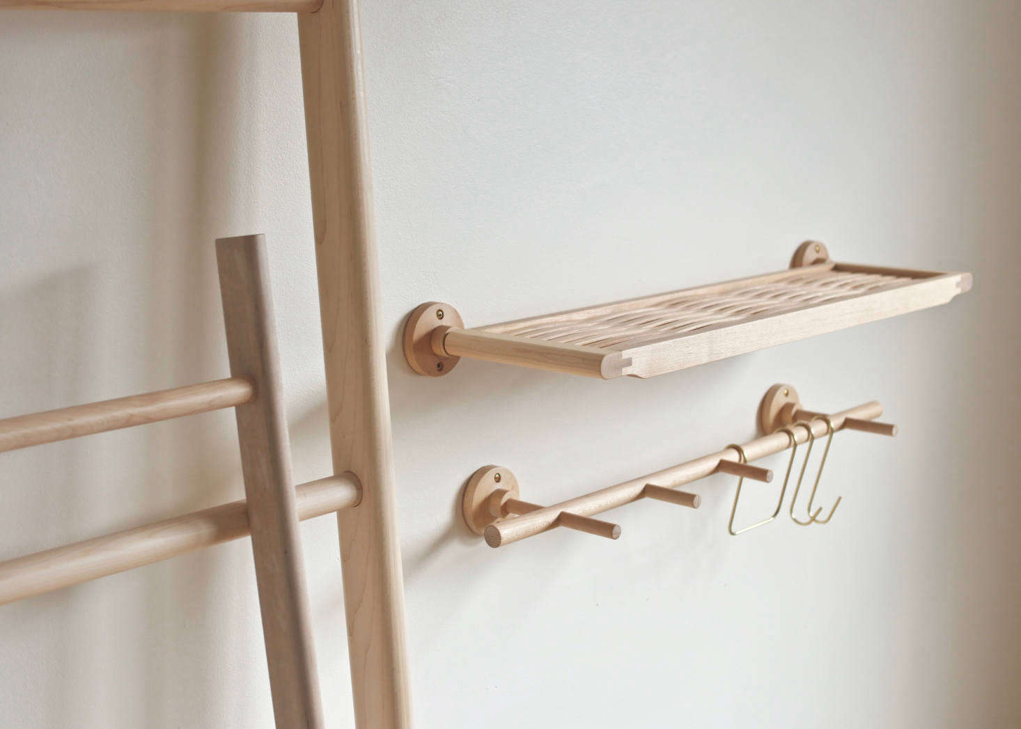 A Woven Shelf in maple with brass hardware.