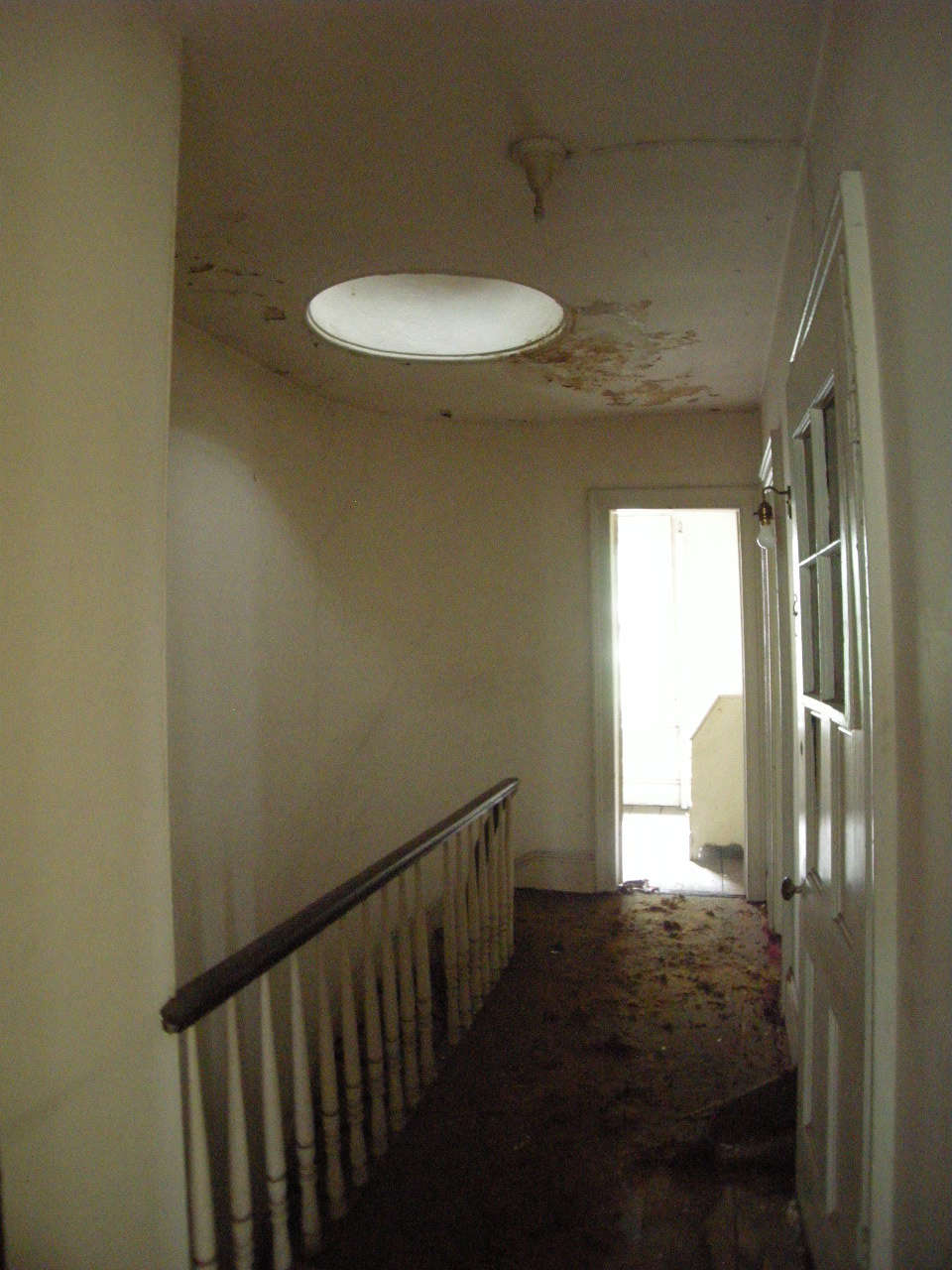 The top floor hall with skylight and banister that's still in use.