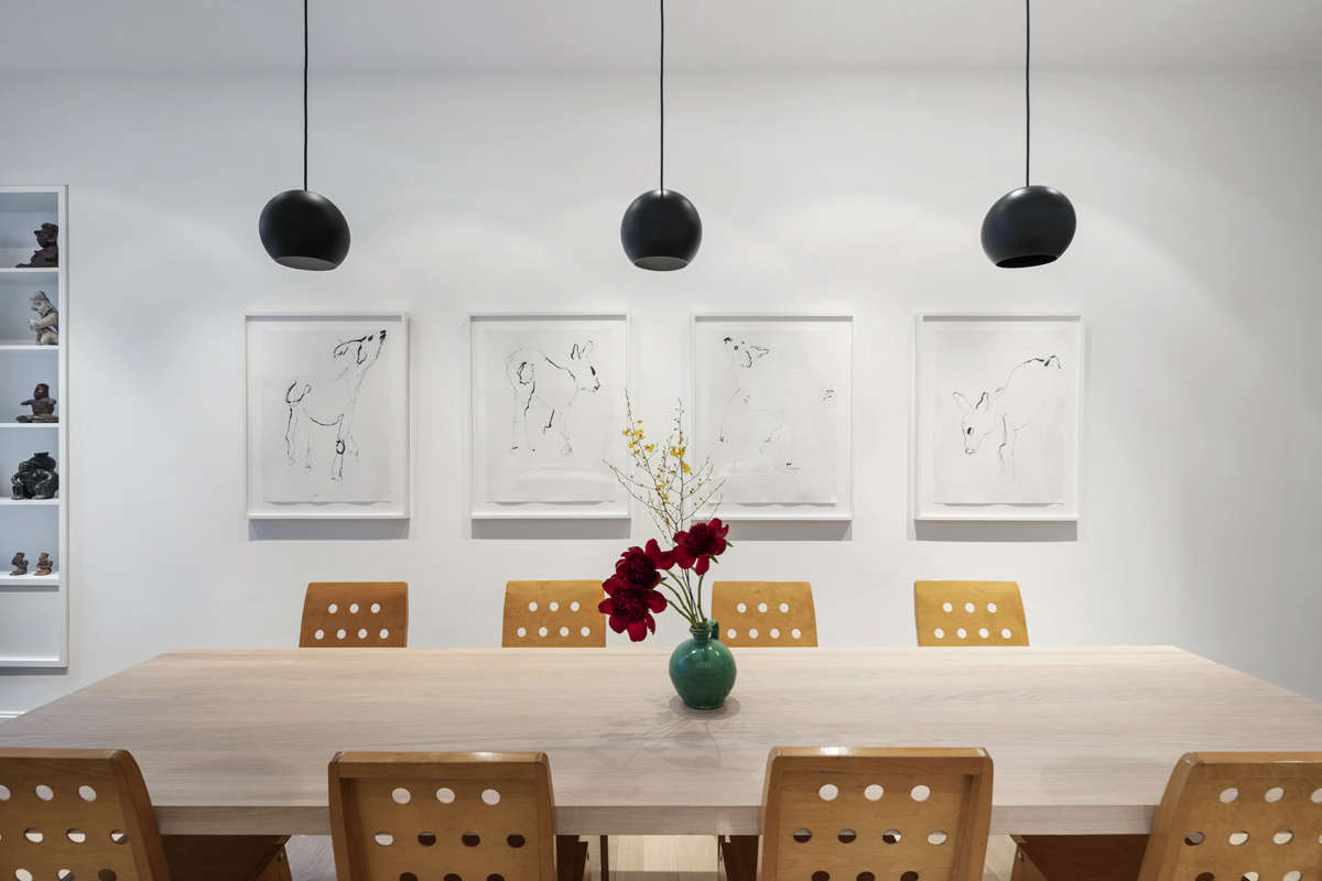 O'Neill's firm oversaw the architectural elements and the hardware, but Sam and his partner decorated the home themselves with vintage finds and modern art. The quartet of drawings is by Sam's father. The vintage dining chairs were designed by Roland Rainer for the Vienna City Hall.
