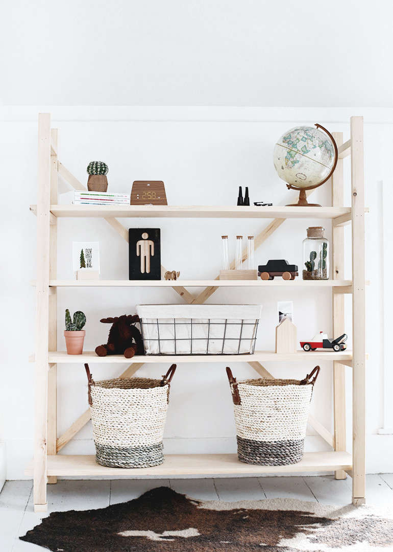 "Manda and Caitlin describe their DIY Wood Bookshelf as ""scaffolding style."" It was inspired by Anthropologie's Toscana Bookcase."