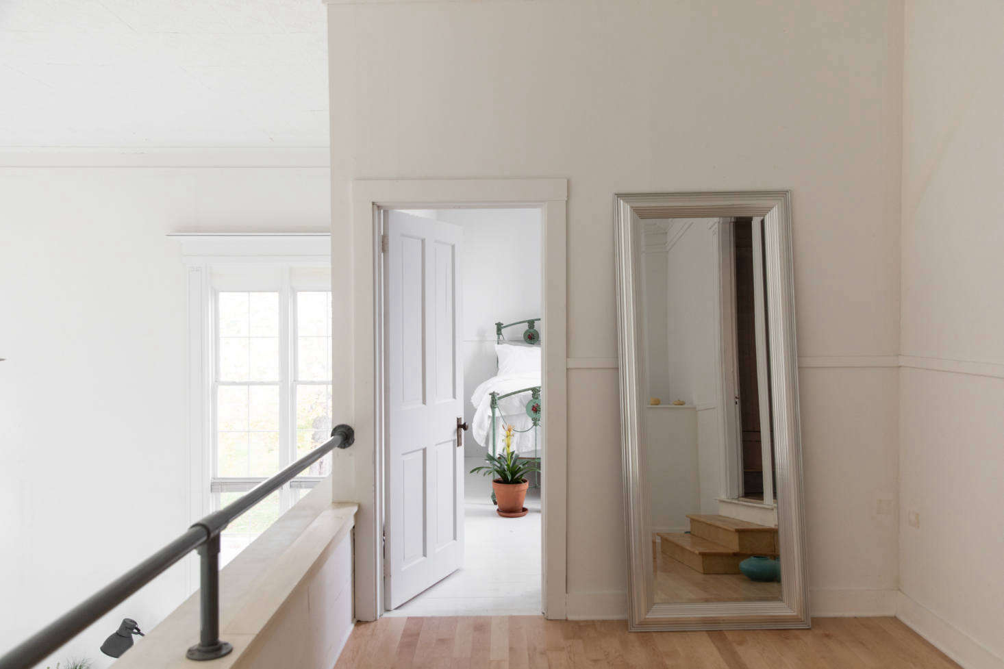 Upstairs on the landing, looking into the third bedroom.