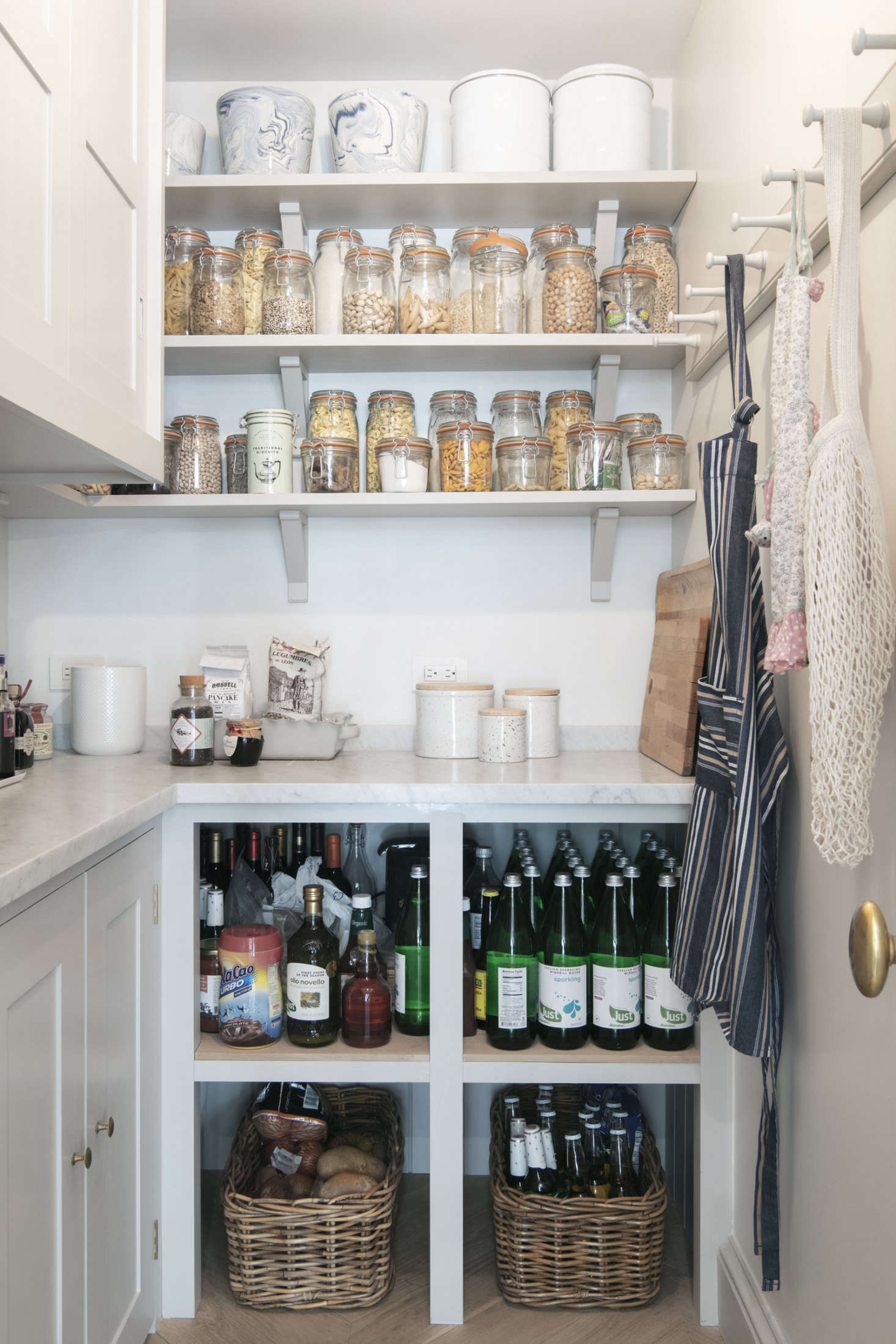 And, before you start decanting your grains and labeling your baskets, check out 10 Things Nobody Tells You About Organizing Your Pantry for some insider tips you might not have thought about. Photograph by Dustin Aksland.