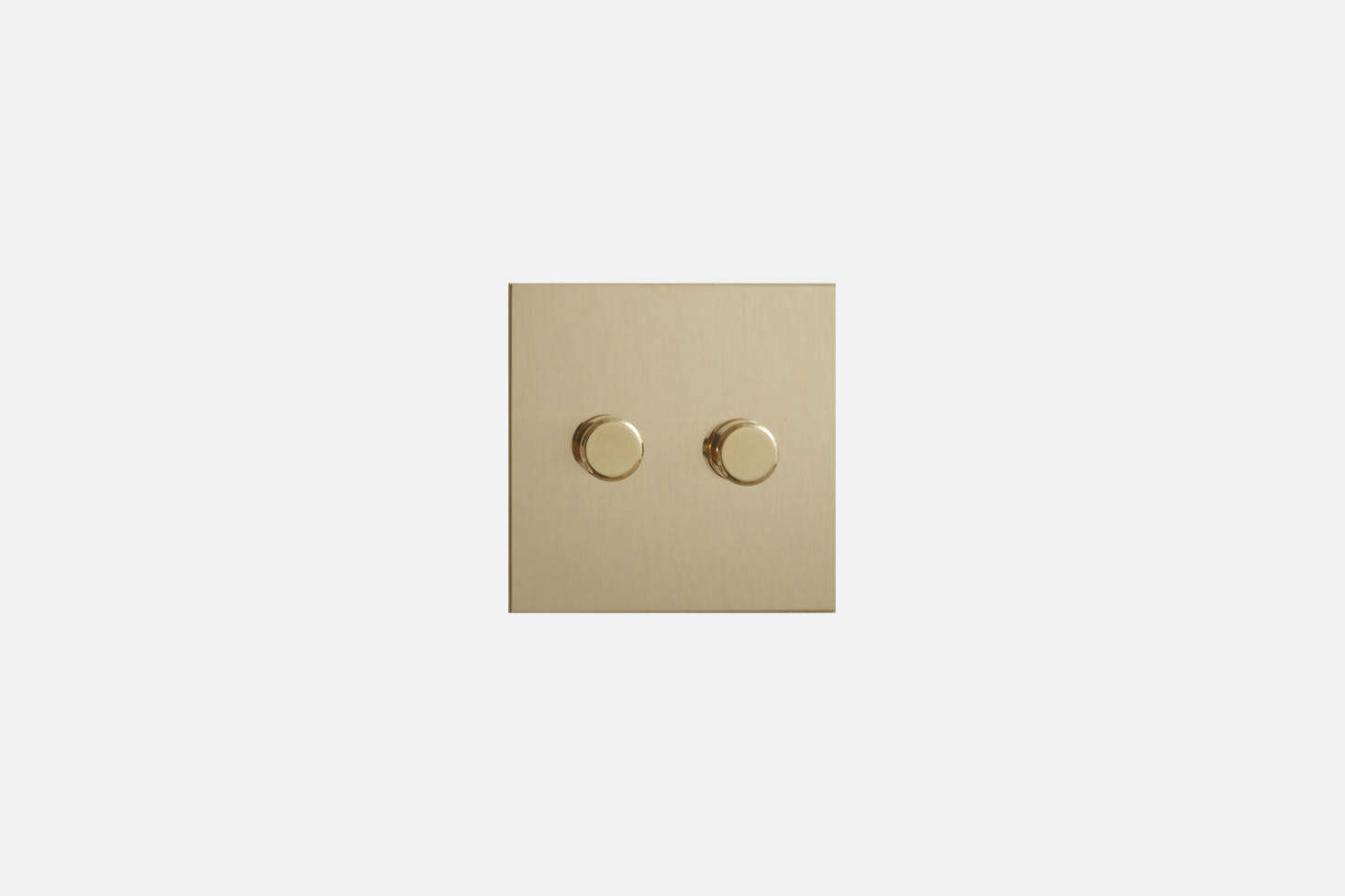 The Forbes & Lomax Unlacquered Brass Rotary Dimmer is featured in the kitchen. Contact Forbes & Lomax for ordering information.