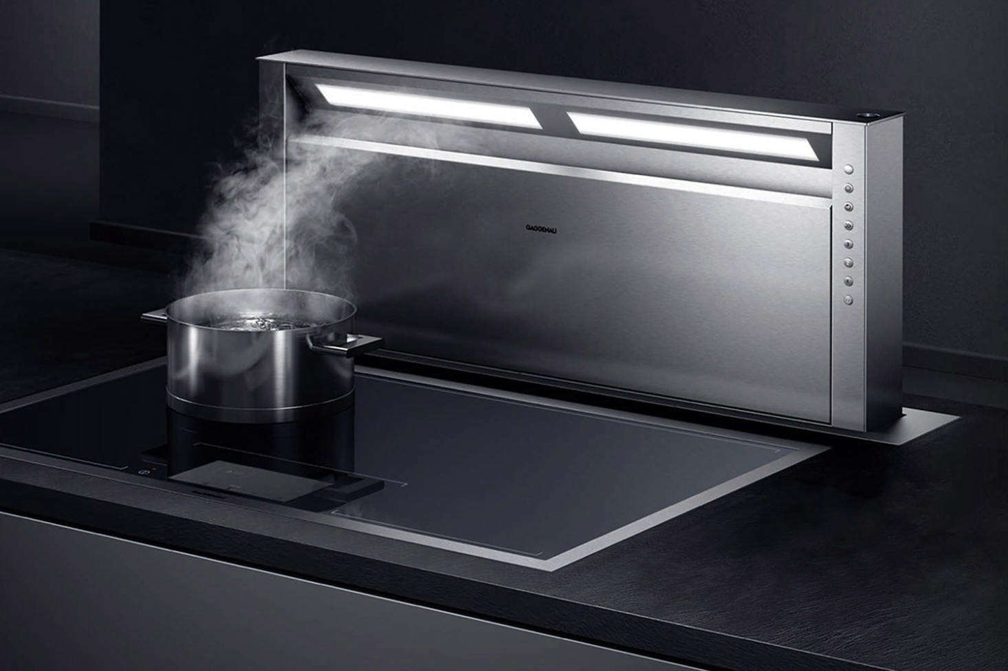 The gaggenau 400 series retractable downdraft vent comes in two sizes and is positioned at the