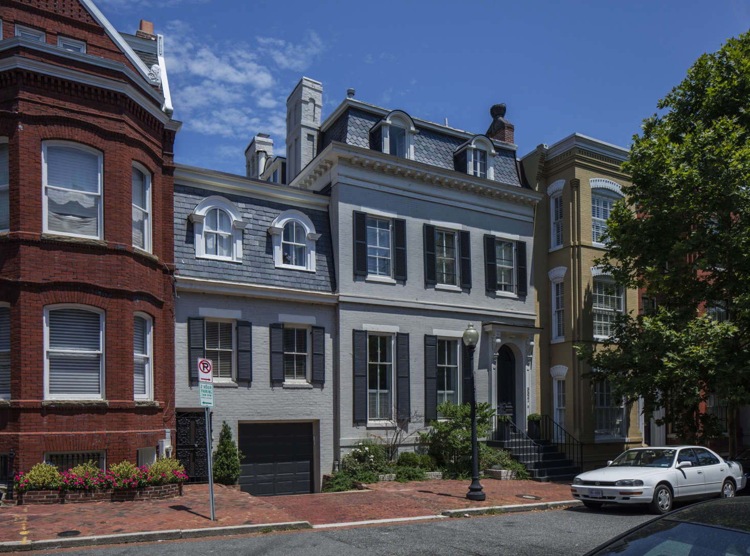 Built in the mid-th century, the mansard-roofed Victorian with attached carriage house is three doors from JFK&#8