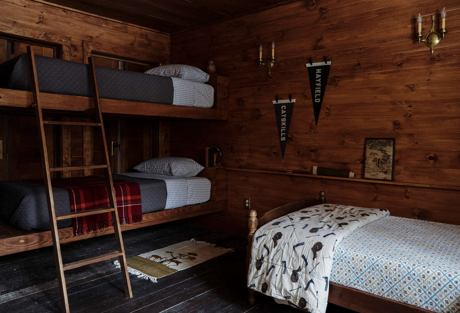 The newly paneled bunk room features custom beds by Percy.