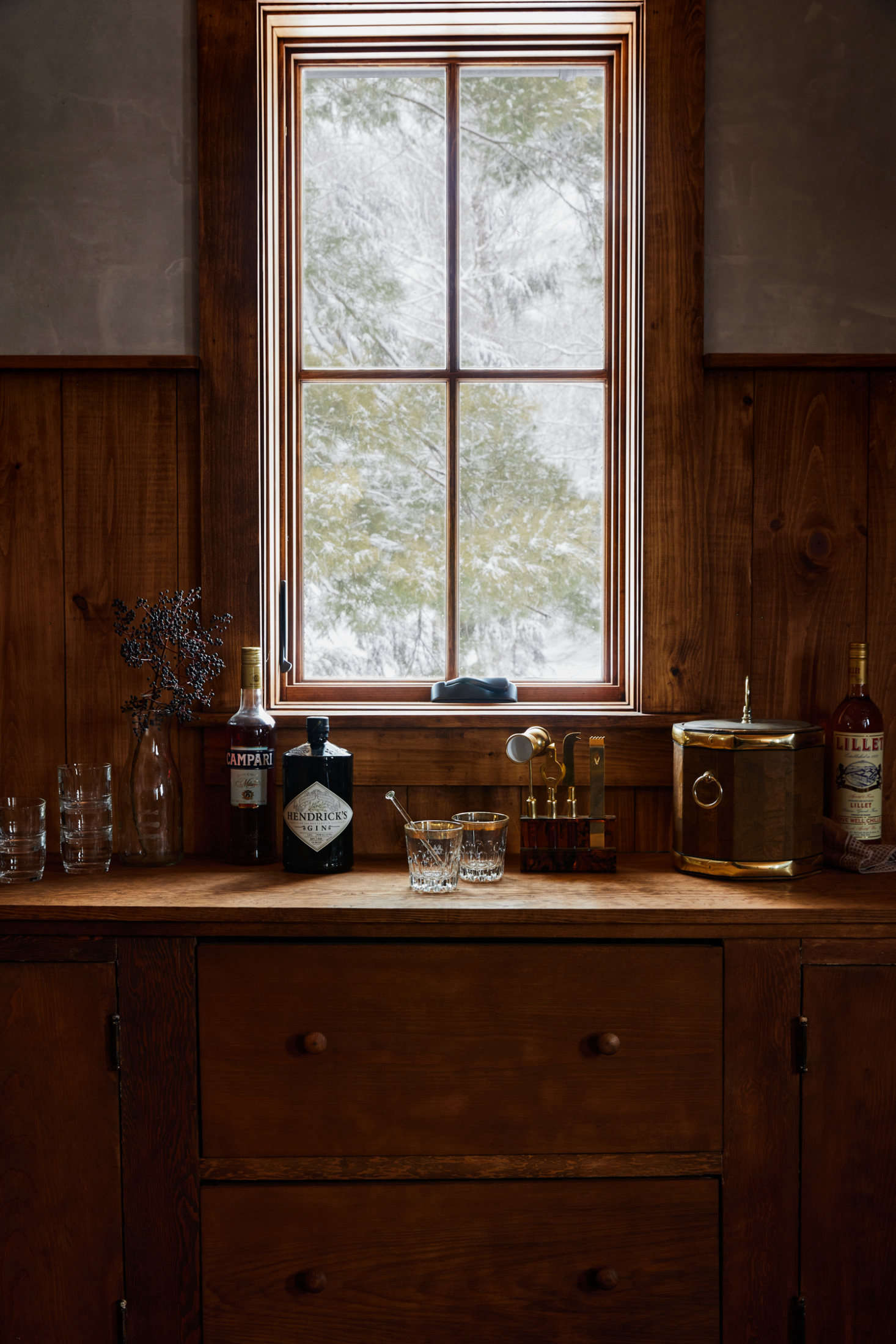Though it looks original to the house, the bar in the groom's room is actually new, fashioned by Jersey Ice Cream Co. from the old kitchen cabinets.