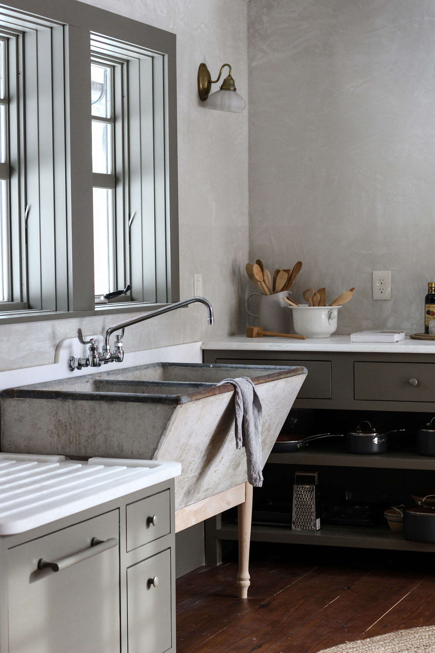 "Another Round Top score, the vintage sink, with pedestal legs fashioned by Percy, is the ""showstopper"" of the kitchen."