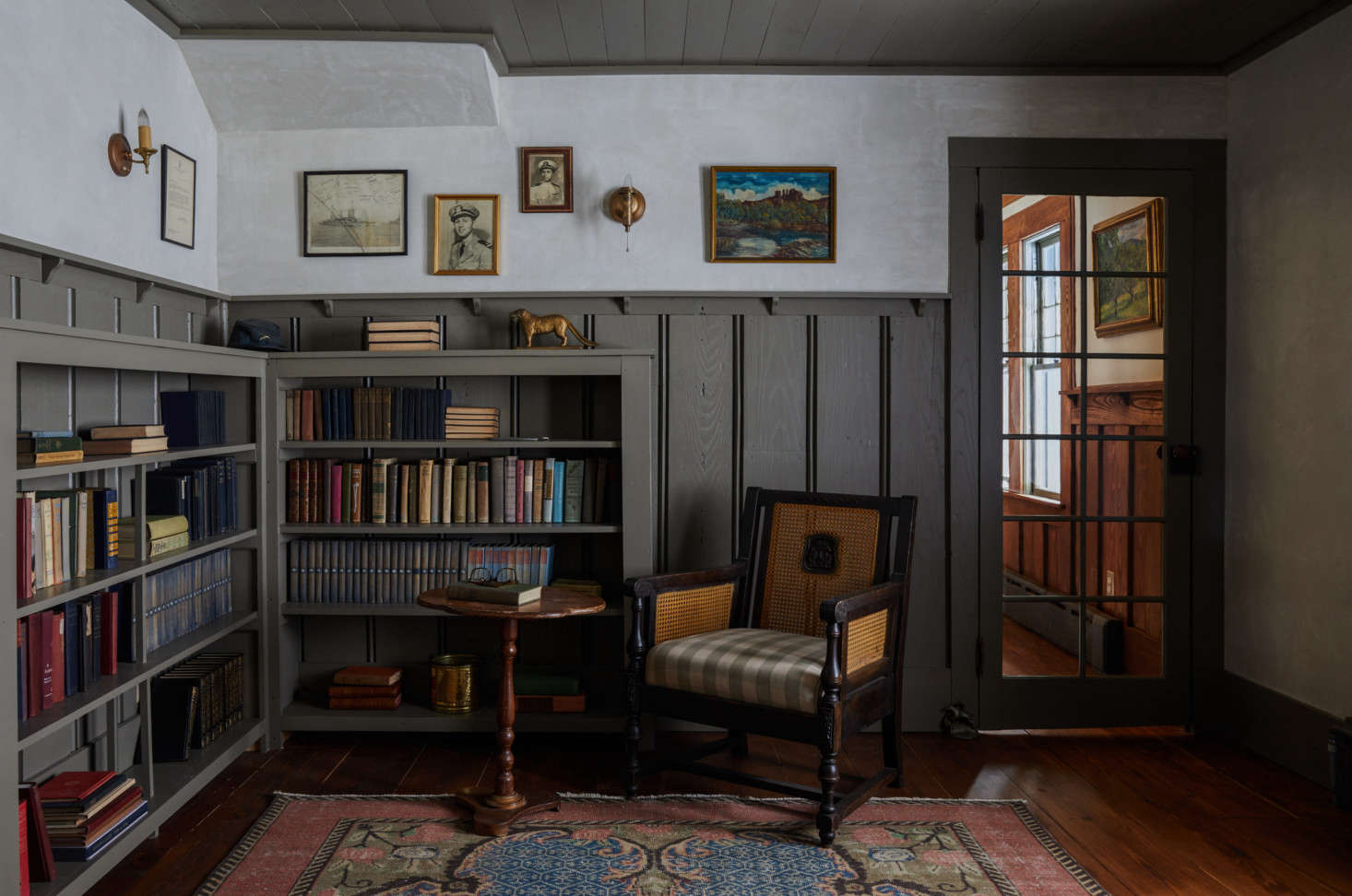 When the couple purchased the home, they found many bits of ephemera, including old photos and books that now occupy the home's intimate library.