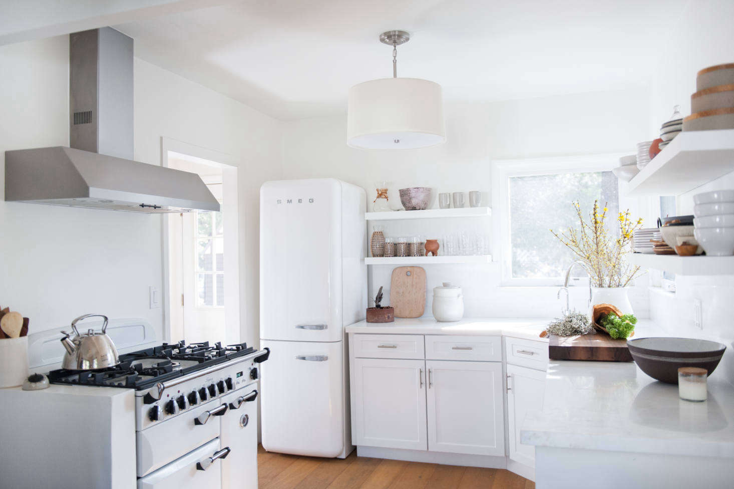 """""""Michael and I both grew up in England, which explains our appliance choices,"""" Leanne tells us. The fridge is a Smeg—""""it has an old-fashioned look that we love""""—and the range is an Aga."""