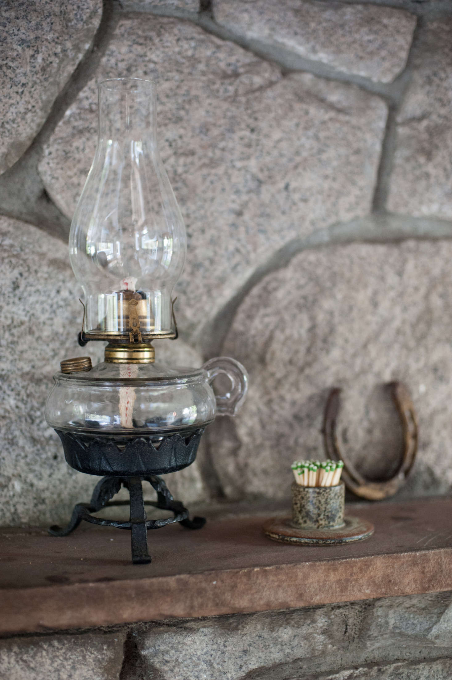 """The kerosene lamp was a housewarming gift from a friend who picked it up on a visit home to Michigan: """"I love it, but so far have been too scared to use it,"""" says Leanne."""