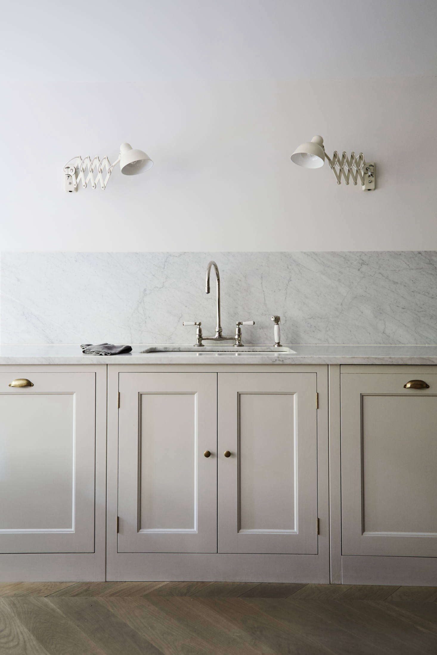 "The counters are topped with Carrara marble that continues as a backsplash. All of the faucets throughout the house are Barber Wilsons designs—and like the kitchen, the owner had them sent from London: ""You can get them in this country but I went to Holloway's of Ludlow. Even with shipping, I paid considerably less."" (During installation, their crew consulted with the ""very knowledgable"" Barber Wilsons customer service team based in Riverhead, New York.)"