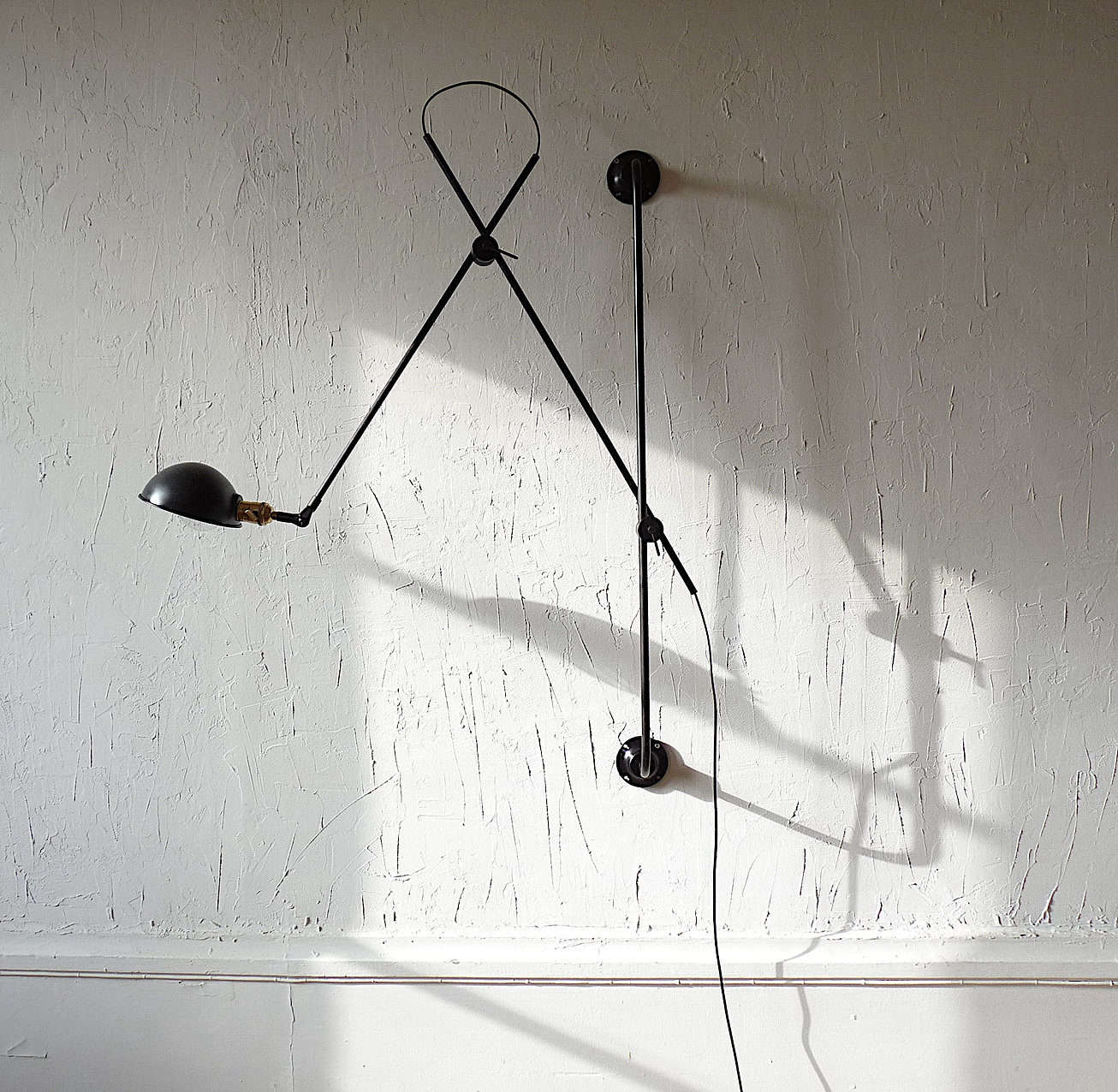 Made in Villeurbanne, France, the Adjustable Two-Arm Wall Lamp by lighting atelier Wo & Wé is made of black steel, and is comprised of a black rod affixed to the wall with articulating arms attached. It's available on request for €659, and can be wired for installation or plug-in.