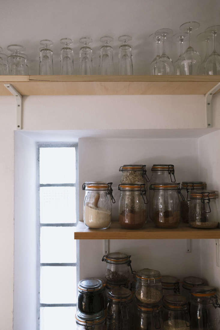 Kitchen with Open Shelves in Celine Sathal's Remodeled Country House in France, Photo by Eefje de Coninck