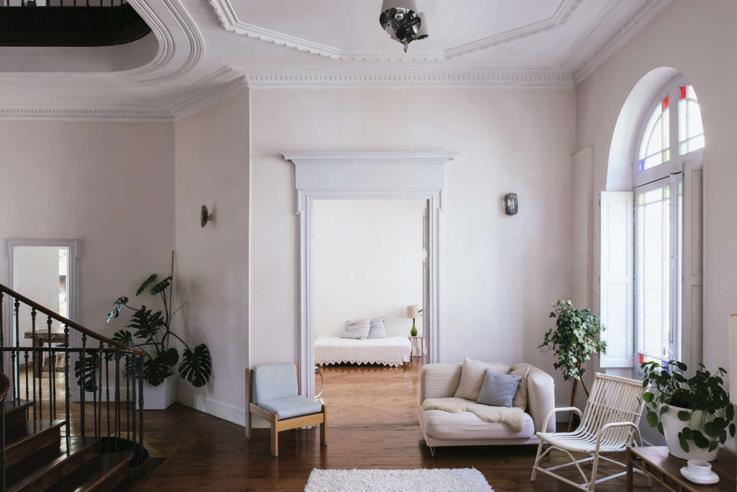 """""""The pastel painted walls were already there and I liked their weathered side,"""" Sathal says of the pale pink walls. """"The trim is typical of the style of the house and is original."""""""