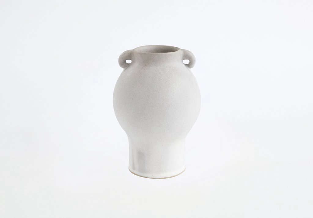"""Clam Lab founder Clair Catillazfocuses on """"elegant, form-focused objects that are made to be touched and used"""" and are produced in small batches on a human-powered kick wheel or cast from handmade molds. (Read more about her practice atCeramics Inspired by 20th Century Forms.) The Gray Venus Vase shown above is $320 from Primary Essentials."""