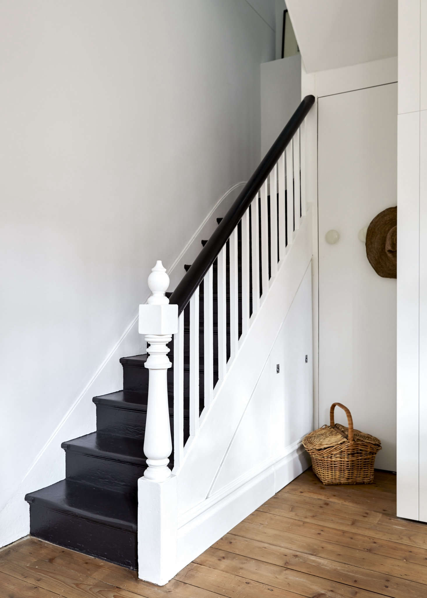The interior had been largely stripped of original detailing and lacked a kitchen, but the entry retained its original stair and Baltic pine floor, which was replicated elsewhere. (Scroll down to see some Before shots.)Whiting used the space under the stairwell for &#8