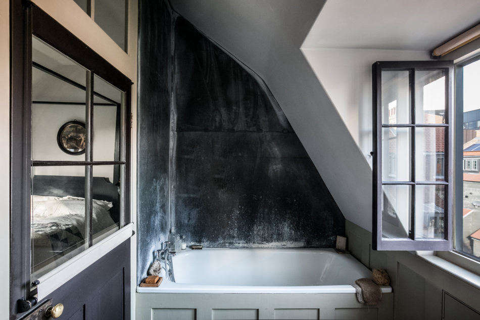 An ensuite bath, with rooftop views.