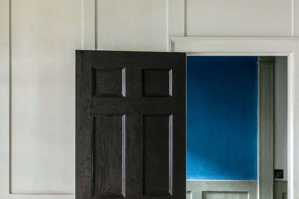 His favorite dash of color in the house: the blue verditer painted onto handmade sheets of paper from Griffen Mill in Ireland. He had been testing out the color for the Strawberry Hill House project but ended up keeping it up in his home.