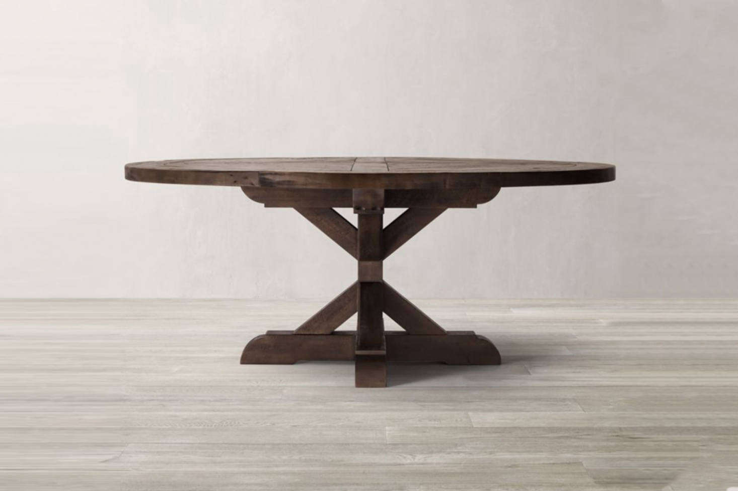 Another off-the-shelf option is the Restoration Hardware Salvaged Wood X-Base Round Dining Table which starts at $2,095—or comb your local flea markets and vintage furniture resources for a similar pedestal dining table.