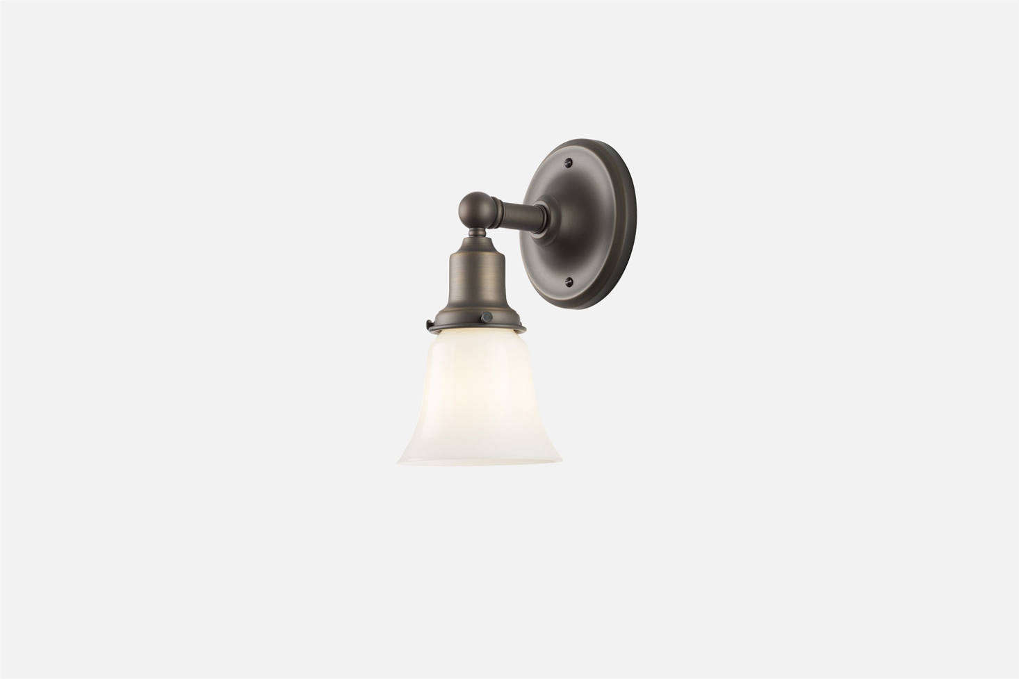 The Schoolhouse Irvine Single Sconce, shown in Matte Bronze, can be paired with any Schoolhouse lampshade; $169. It's an off-the-shelf version of the vintage wall sconce sourced for the kitchen. Another style is the Emory Sconce also from Schoolhouse.