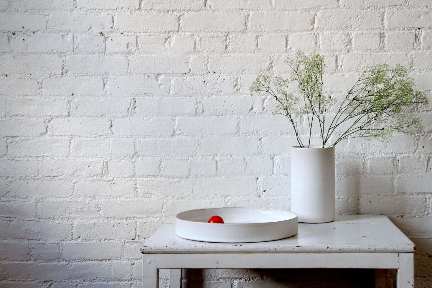 We've admired Tracie Hervy's delicate, perfectly proportioned ceramic pieces for a while now; but we hadn't seen her work in person until this fall's Field + Supply in Kingston, NY (it was worth the wait). We especially like her Shallow White Stoneware Tray, which is $88 from new online shop Bloomist.