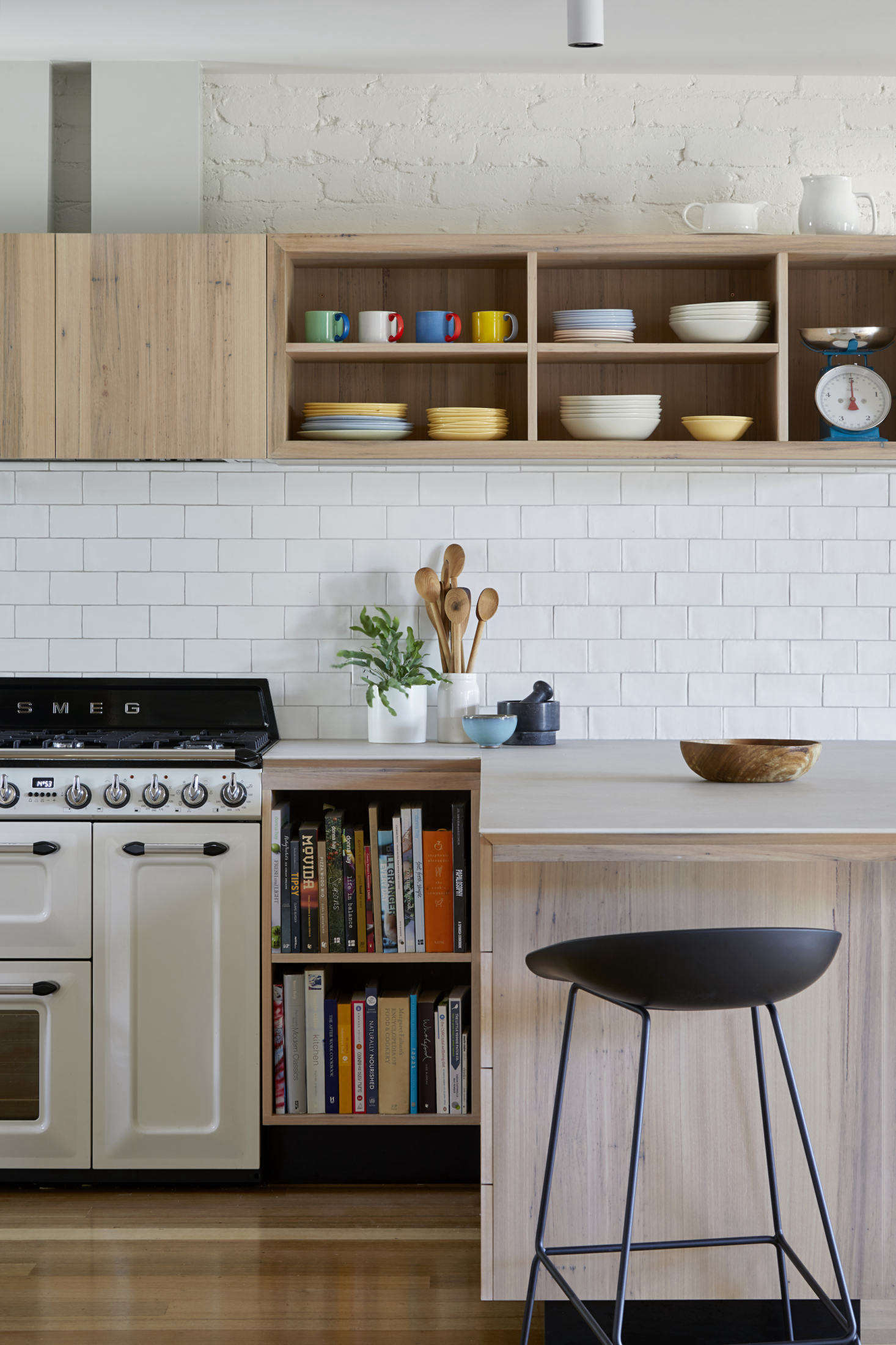 The cabinets are made from lime-washed blackbutt timber; the countertops from Maximum &#8