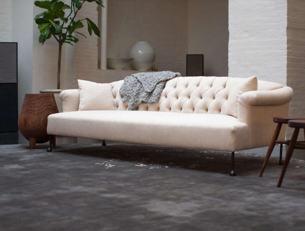 The luxe BDDWEdmund Sofa has a solid wood frame with mortise and tenon joinery. It's made with feather, wool, and cotton cushion, horsehair and cotton arms and back, and cast-bronze ball feet. Contact BDDW for pricing (the sofa is available in six sizes, in addition to custom sizing).