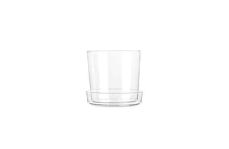 A Glass Flower Pot, made of borosilicate glass, has a small hole in the bottom for drainage and a saucer to collect water, but could also be used for kitchen or bath storage. It's 150 SEK from Arket.