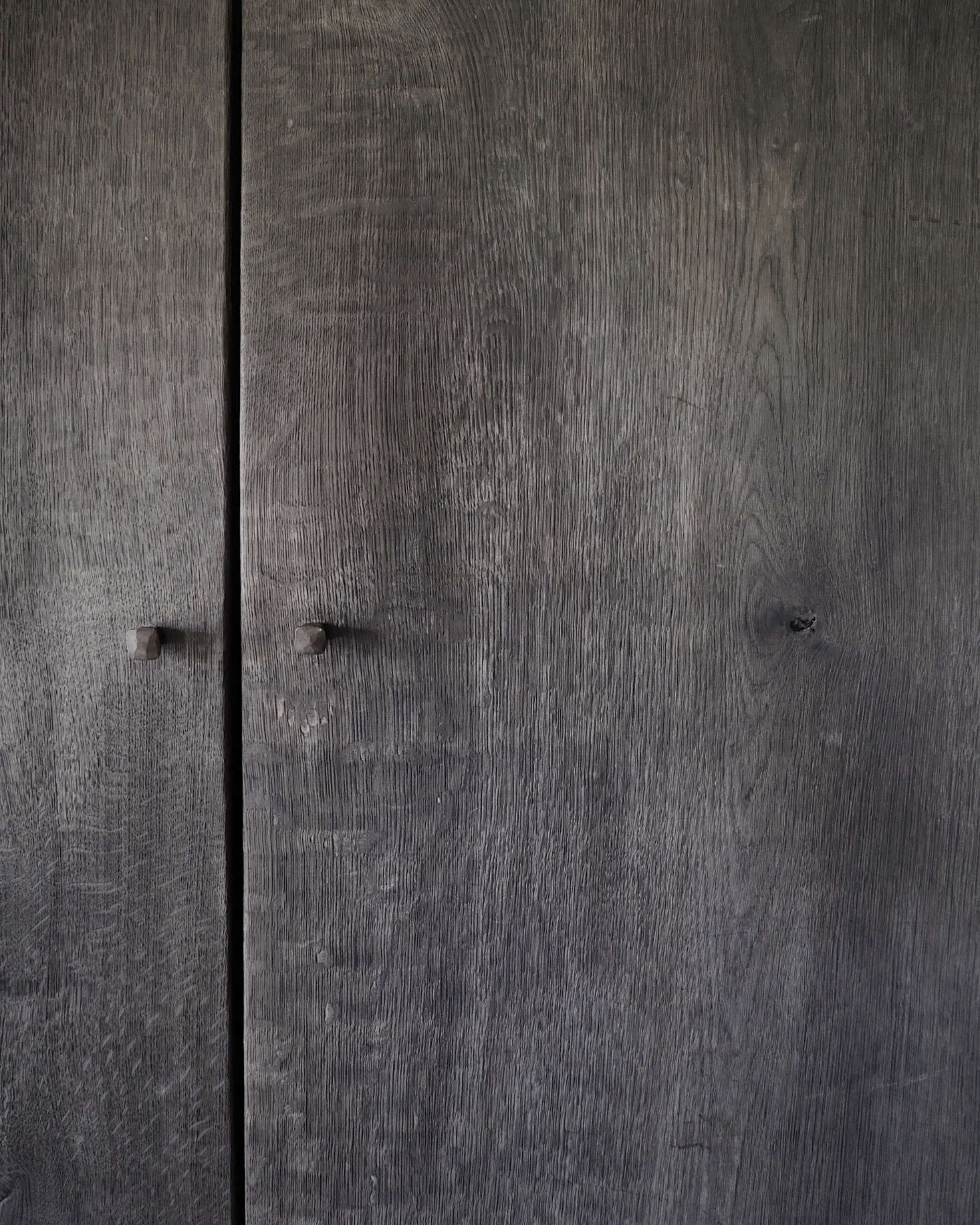 787025f28f Hand-forged nails serve as knobs on the bedroom wardrobes made by Belgian  designer