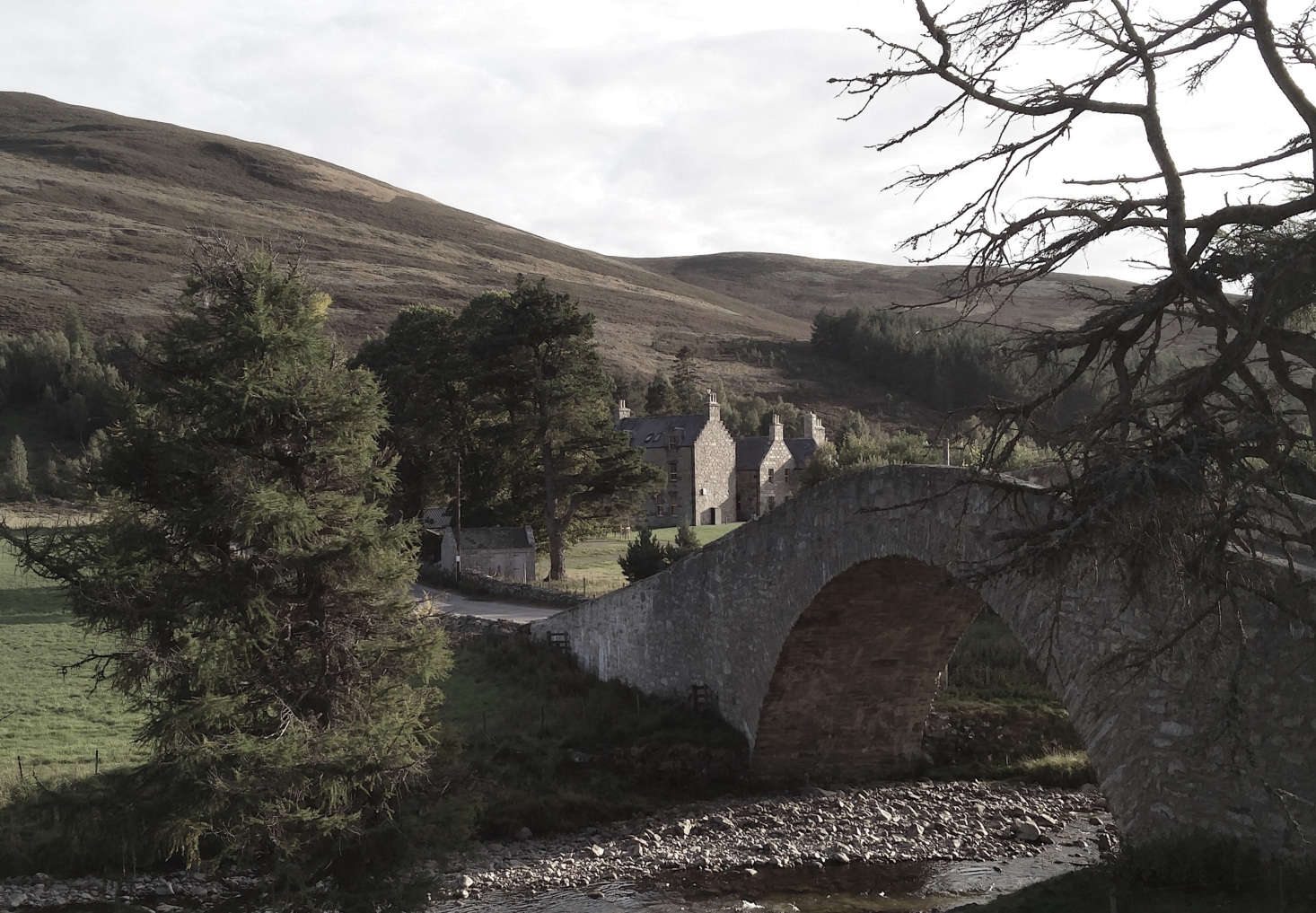 The Gairnshiel Bridge was built over the River Gairn in the 18th century. There are 20,000 private acres surrounding the lodge and beyond that is parkland.