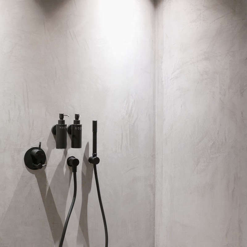 The showers are also finished with Stuc. The matte black fixtures are from Phoenix of Australia's Vivid Slimline collection.