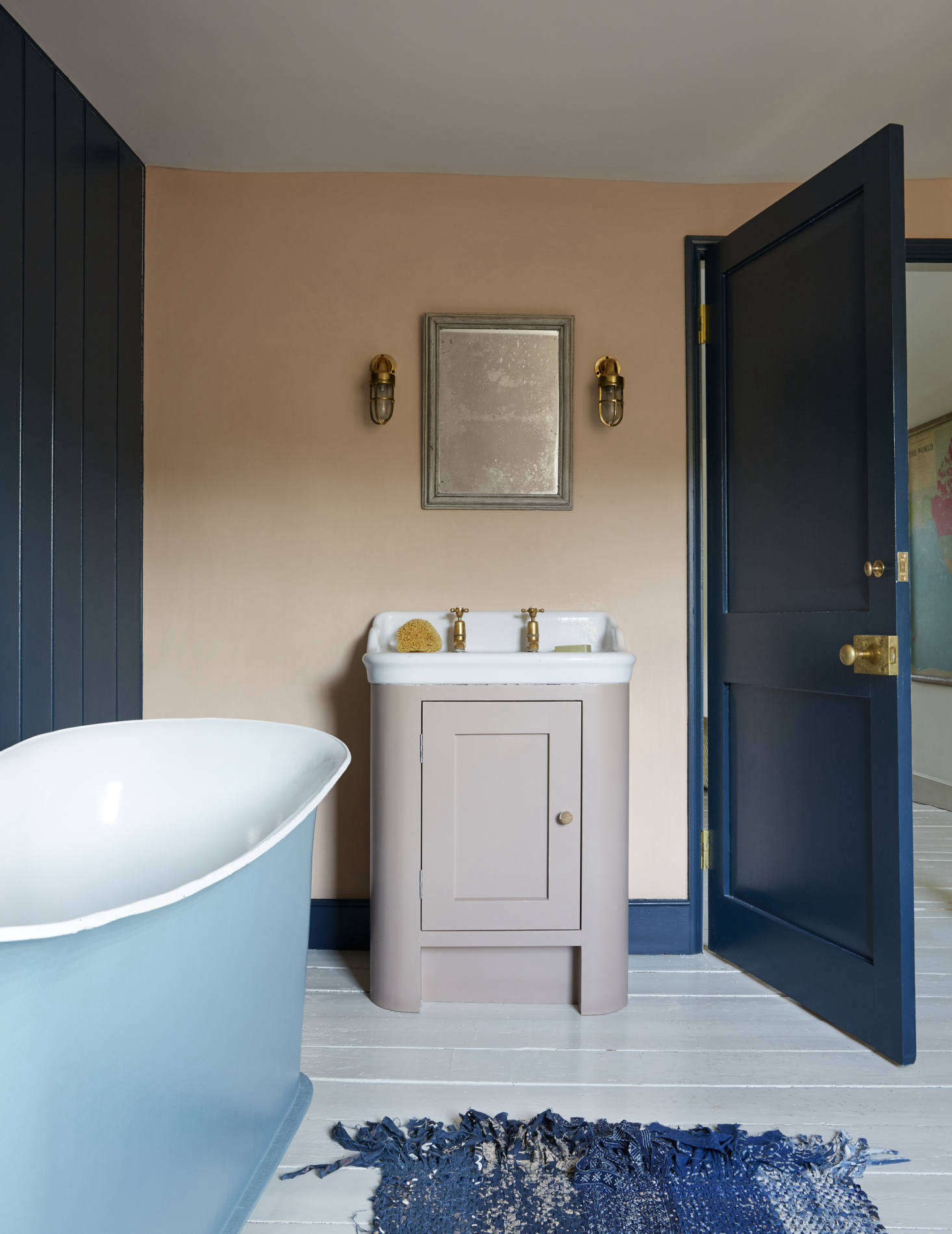 """The kids' bath features an Antique Cabinet Basin from The Water Monopolyand one of Harding's most inspired mix of colors: Farrow & Ball Setting Plaster on the walls, Hague Blue on the woodwork, and Smoked Trout on the washstand How did she come up with these? """"Just a gut feel. I love dreaming up soulful combinations."""""""