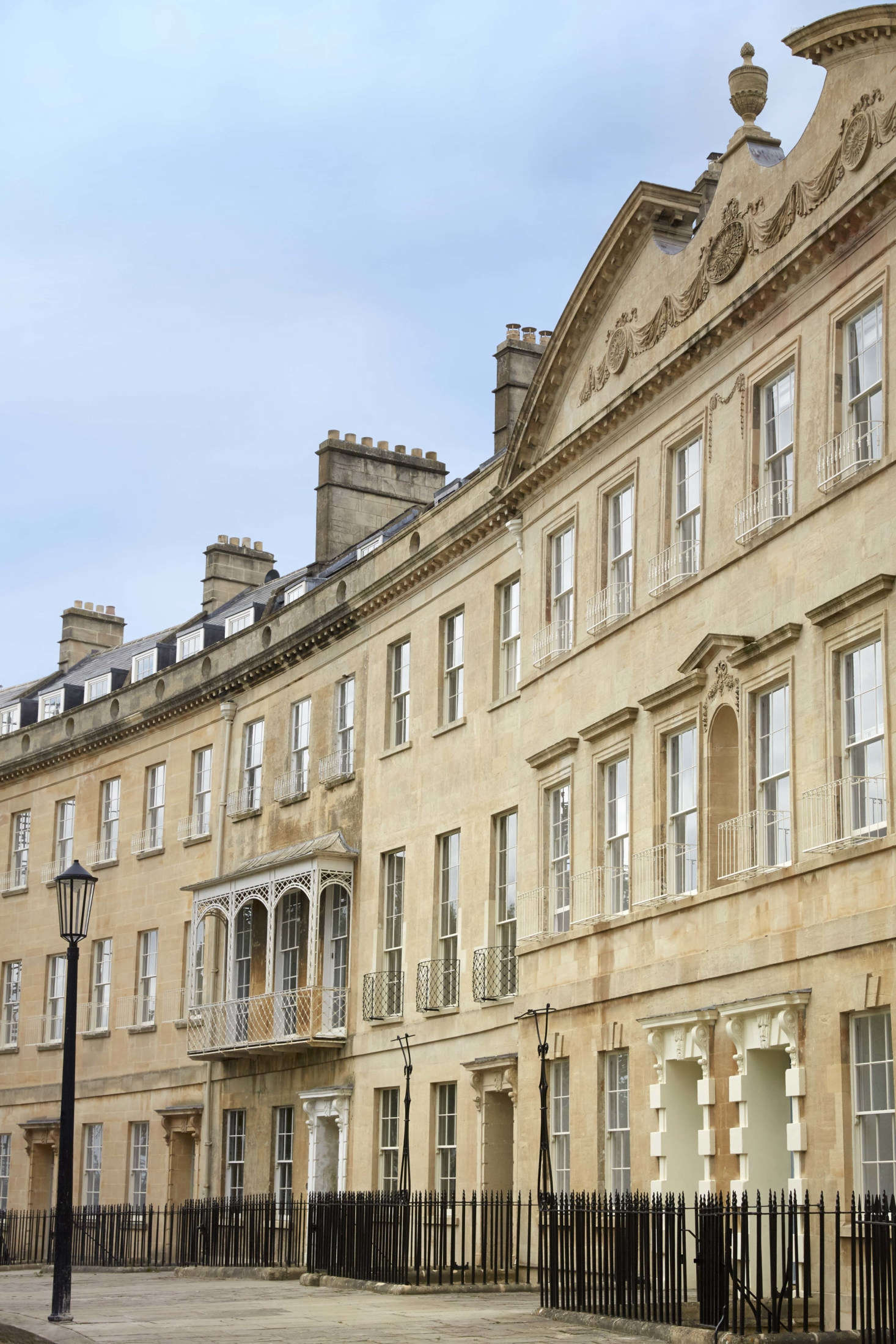 """The 1790 crescent was designed by architect John Eveleigh and is comprised of 10 adjoining townhouses. It's built of the prized local golden limestone known as Bath stone and is Grade 1 listed—Britain's status for """"buildings of exceptional interest."""""""