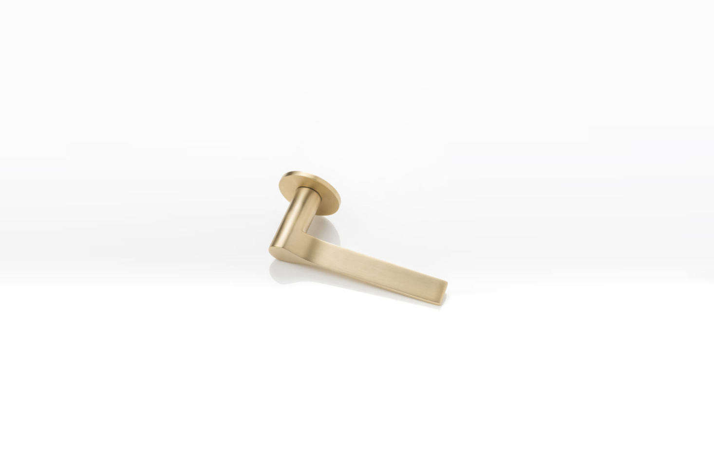 The Joseph Giles LV1045 Fonteyn Solid Brass Lever Handle with a unique rota-bearing sprung rose is available in Brushed Brass Waxed (shown), Polished Wax Brass, and Mid Antique Brass Waxed. Contact Joseph Giles for price and ordering information.