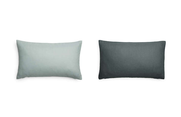 Arket carries a series of pillow covers in a variety of colors, like these Linen Lumbar Cushion Covers in pale green and grey (150 SEK each).