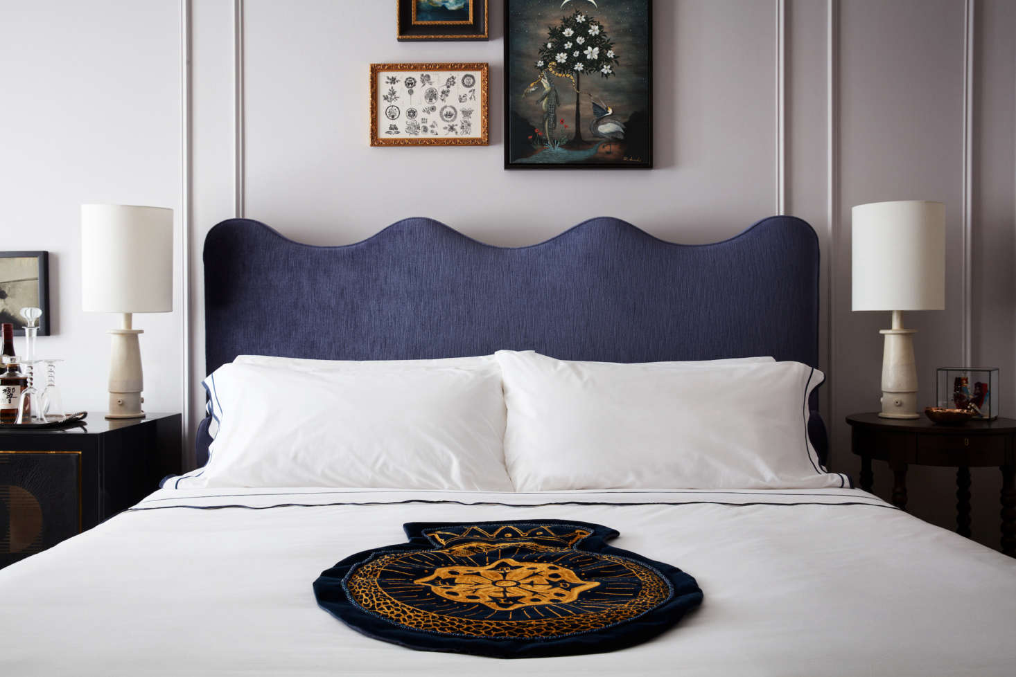 Guest beds are laid with regal-looking cloth crests.