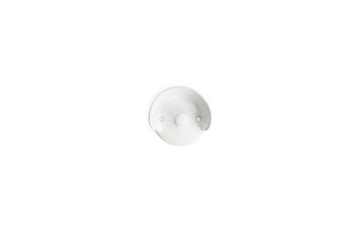 """TheA01 Wall Hookby Swedish brand Massproductions is made in Portugal and provides two places from which to hang things: the knob and the """"hood"""" above. It's 300 SEKfrom Arket."""