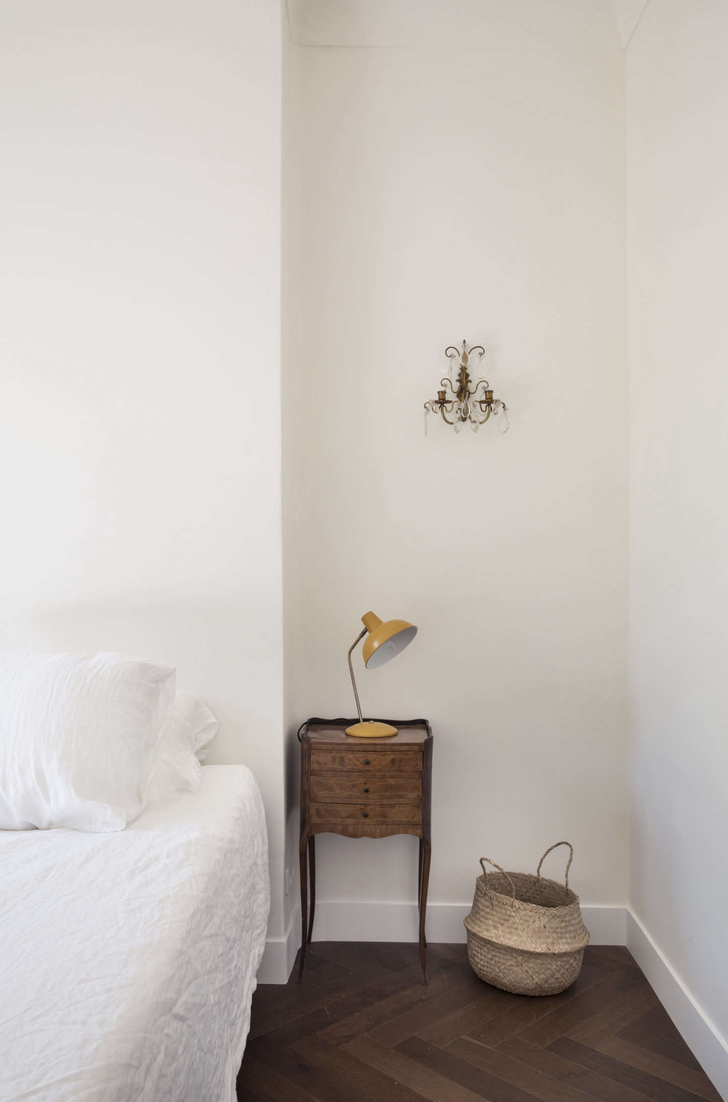 The bedside tables are from the Antibes brocante market and the sconces are from Cours Saleya in Nice.