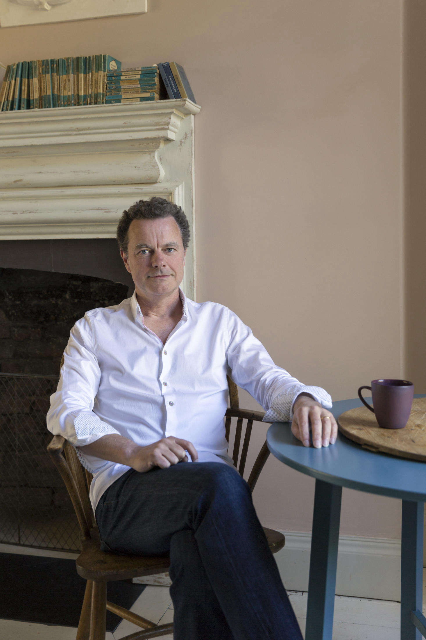 """Nick Gilpin purchased the house in 2013—and had the resources and stamina to see it through. """"His genius is in masterminding the details that you can't see, such as the cleverly concealed uplights in all the window recesses that beautifully wash the paneling,"""" says Harding. """"Historic houses and good design are his great loves."""" Photograph by Claudia Rocha, courtesy of Howe."""