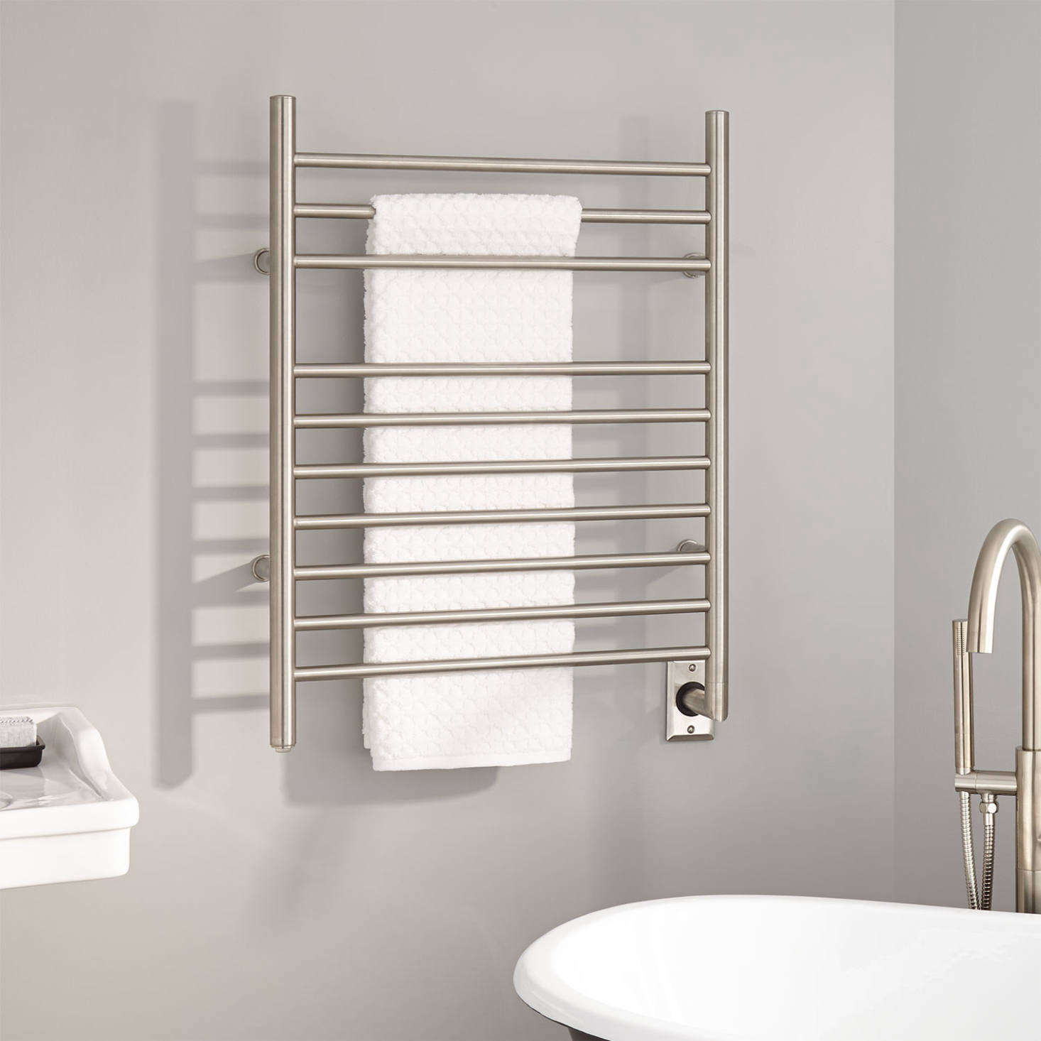 The 24-Inch Contemporary Hardwired Towel Warmer is currently on sale for $92.99 at Signature Hardware.